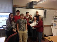 ACT Chair Cindy Krautheim presenting movie passes to students in the Career Development Center Business Class.